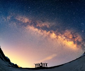 People looking up in the night sky Stock Photo