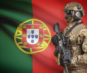 Portuguese flag with heavily armed soldiers HD picture