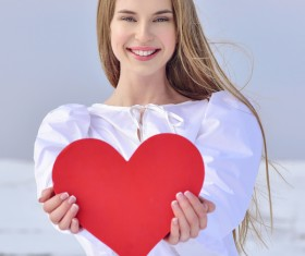 Smiling girl heart-shaped Stock Photo