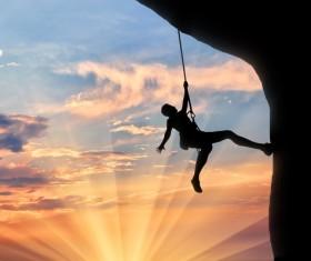 Sunset rock climbing Stock Photo