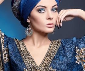 Wearing a folk costume wearing beautiful women earrings