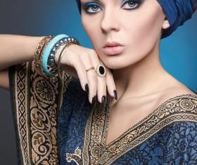 Wearing a folk dress to wear jewelry beautiful women