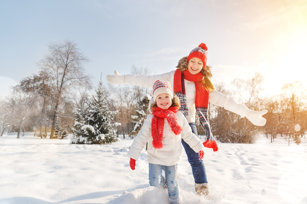 Winter Mother and daughter playing snow outdoors Stock Photo 01