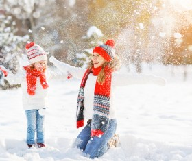 Winter Mother and daughter playing snow outdoors Stock Photo 02