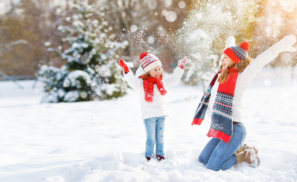 Winter Mother and daughter playing snow outdoors Stock Photo 03