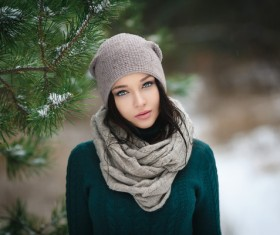 Winter outdoor lovely girl with pine branches Stock Photo 01