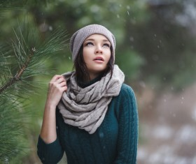 Winter outdoor lovely girl with pine branches Stock Photo 04