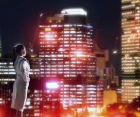 Woman looking at night city stock photo 01