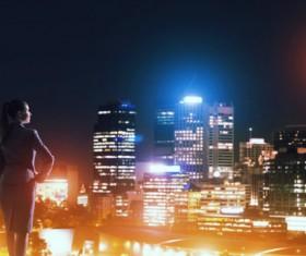 Woman looking at night city stock photo 05
