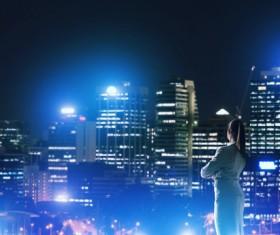 Woman looking at night city stock photo 08