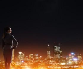 Woman looking at night city stock photo 09