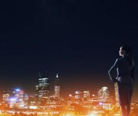 Woman looking at night city stock photo 11