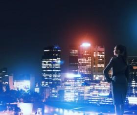 Woman looking at night city stock photo 12