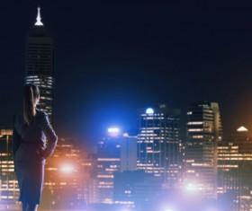 Woman looking at night city stock photo 14