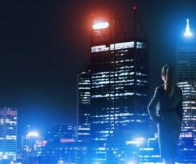Woman looking at night city stock photo 15