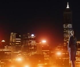 Woman looking at night city stock photo 16