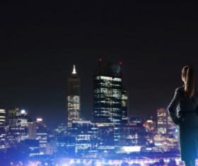 Woman looking at night city stock photo 18