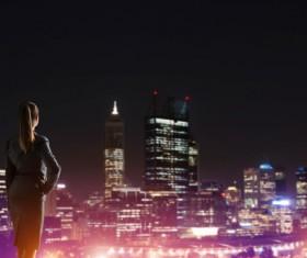 Woman looking at night city stock photo 19