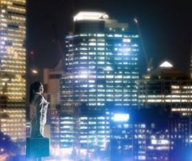 Woman looking at night city stock photo 20