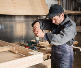 Wood frame drilling Stock Photo