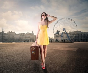 A female tourist carrying luggage Stock Photo
