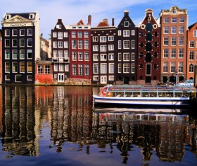 Amsterdam canals and sightseeing boats Stock Photo