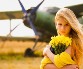Bouquet of girls with old-fashioned airplane Stock Photo