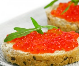 Bread slices with red caviar vegetables Stock Photo