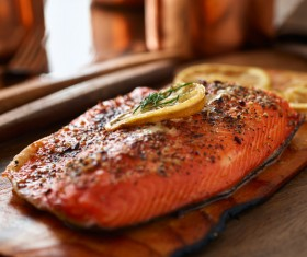 Delicious grilled salmon with lemon slices HD picture