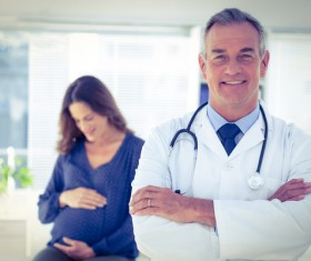 Doctor with pregnant woman Stock Photo