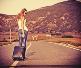 Fashion girl on the road with luggage bag HD picture