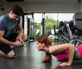 Fitness coach to guide girls fitness movements Stock Photo 01