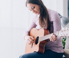 Girl playing guitar HD picture