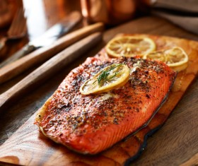 Grilled salmon with lemon slices HD picture