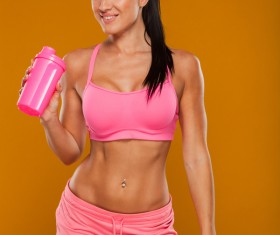 Holding a cup of fitness woman HD picture