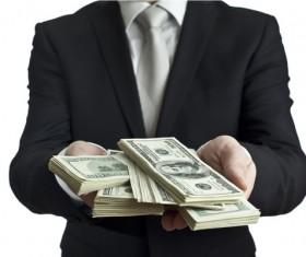 Holding the dollar Stock Photo