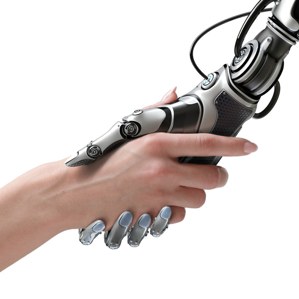 Intelligent robots shake hands with people Stock Photo