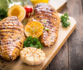 Lemon slices and grilled meat HD picture