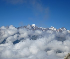 Sea of clouds and snow-capped mountains Stock Photo