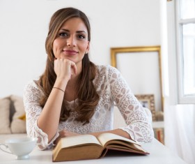 Smiling woman with book Stock Photo