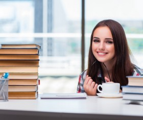 Smiling young female student and book HD picture