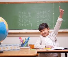 Teachers in the study of children Stock Photo
