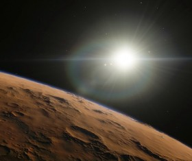 The barren planet and the sun Stock Photo