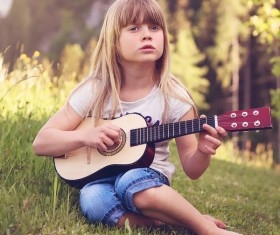 The little girl plays ukree Stock Photo