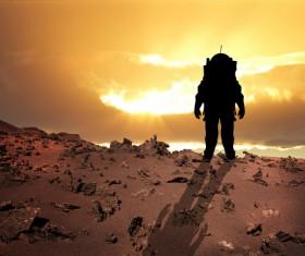 Watching the sunset astronaut Stock Photo