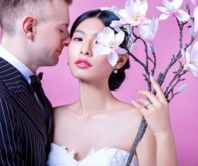 Wedding photographs of newlyweds and flowers Stock Photo