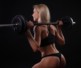 Woman doing barbell fitness exercise HD picture