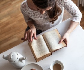 Woman reading a book with coffee dessert Stock Photo