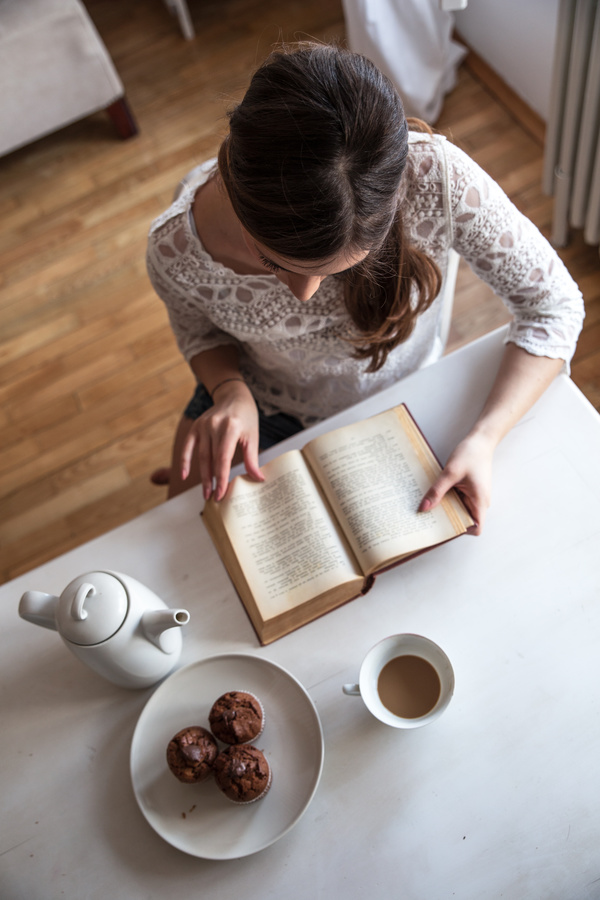 woman reading a book with coffee dessert stock photo free