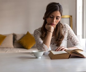 Woman reading with coffee Stock Photo